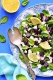 Spinach salad with beet root and feta cheese. Stock Photos