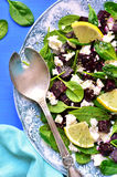 Spinach salad with beet root and feta cheese. Royalty Free Stock Photo