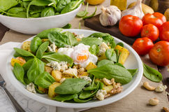 Spinach salad with egg benedict Royalty Free Stock Photo