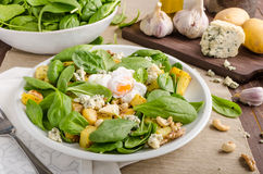 Spinach salad with egg benedict Stock Image