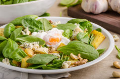 Spinach salad with egg benedict Royalty Free Stock Image