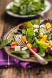 Spinach Salad. Fresh spinach salad with fruit and vegetable stock images