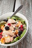 Spinach salad with fruit and feta cheese angled shot Royalty Free Stock Photo