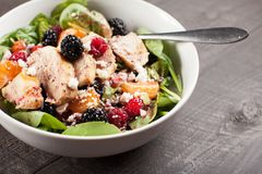 Spinach salad with fruit and feta cheese close up shot Stock Photos