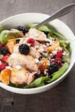 Spinach salad with fruit and feta cheese dark background Royalty Free Stock Photos