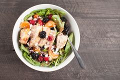 Spinach salad with fruit and feta cheese top view Royalty Free Stock Image