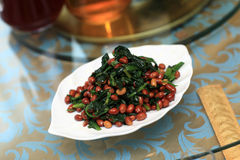 Spinach salad with peanuts Stock Image