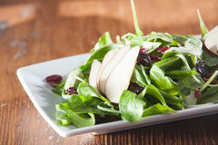 Spinach salad with pears and cranberries Royalty Free Stock Images