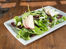 Spinach salad with pears and cranberries Stock Photos