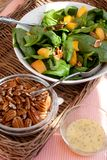 Spinach Salad with Pecans, Peaches and Dressing Stock Photo