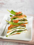 Spinach,salmon,tomato and mozzarella mille-feuille Royalty Free Stock Image