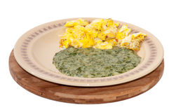 Spinach served on a plate with fried eggs Stock Image