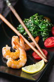 Spinach and shrimps Stock Images
