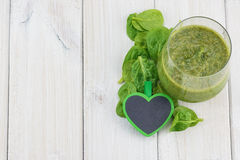 Spinach smoothie with  a green heart. Royalty Free Stock Photo