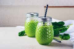 Spinach Smoothie. Healthy green smoothie with spinach in a glass jar stock photography