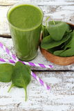 Spinach smoothie. On paint wooden board Royalty Free Stock Photography
