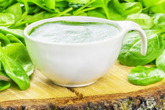 Spinach Smoothie with spinach around Stock Photo