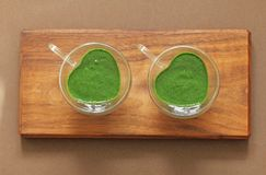 Spinach smoothie on wooden background. Fruit green smoothies in glass and ingredients. Detox, diet, healthy, natural, organic food stock photos