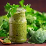 Spinach smoothies. Healthy green juice with ingredients on dark wooden table. Side view. Two Spinach smoothies. Healthy green juice with ingredients on light stock photo