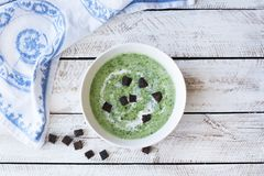 Spinach soup on wooden table Stock Photos