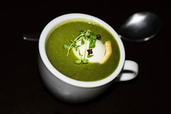 Spinach soup with decorated egg Stock Photos