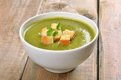 Spinach soup with dried crusts Royalty Free Stock Photo