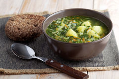 Spinach soup and rye bread royalty free stock images