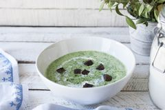 Spinach soup on wooden table Stock Images