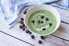 Spinach soup on wooden table Stock Image