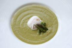 Spinach soupe with egg. Spinach soupe with  egg in deep plate lounch Stock Photo