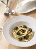 Spinach spaghetti pasta Stock Image