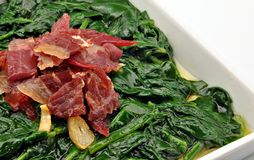 Spinach stew with ham and garlic Royalty Free Stock Photo