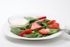 Spinach and strawberries salad Royalty Free Stock Images