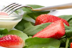 Spinach and strawberries salad Royalty Free Stock Image