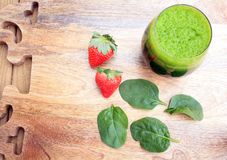 Spinach and strawberry juice and spinach leafs Stock Photo