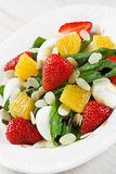 Spinach strawberry orange quail eggs salad with almonds slices Royalty Free Stock Photos