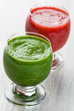 Spinach and strawberry smoothie Stock Photos