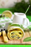 Spinach strudel with omelet and cheese. Royalty Free Stock Photo