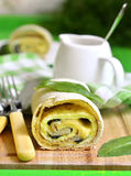 Spinach strudel with omelet and cheese. Royalty Free Stock Images