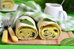 Spinach strudel with omelet and cheese. Stock Images