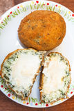 Spinach stuffed rice balls arancini on table. Traditional sicilian street food - spinach stuffed rice balls arancini on plate on table Royalty Free Stock Images