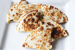 Spinach & sundried tomato quesadilla. Shot of a Spinach & sundried tomato quesadilla Stock Image