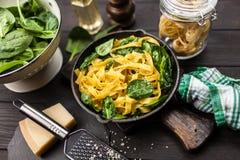 Spinach tagliatelle pasta. Tagliatelle pasta with fresh spinach leaves Stock Photo