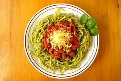 Spinach tagliatelline with bolognese sauce Royalty Free Stock Photos