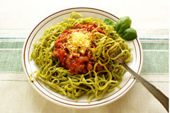 Spinach tagliatelline with bolognese sauce Stock Photo