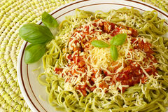 Spinach tagliatelline with bolognese sauce Stock Image