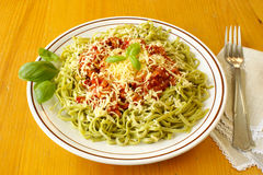 Spinach tagliatelline with bolognese sauce Stock Photos