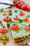 Spinach-Tomato guiche. Quiche with Royalty Free Stock Photo