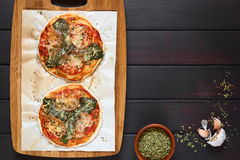Spinach and Tomato Pizza Stock Images