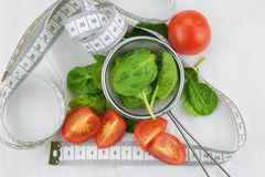 Spinach and tomatoes the ingredients for a tasty and healthy diet. Stock Photo